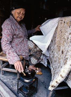 A master at batik tulis sarongs, Ibu Djogo Pertiwi, 96, applies wax using a pencil-like canting.