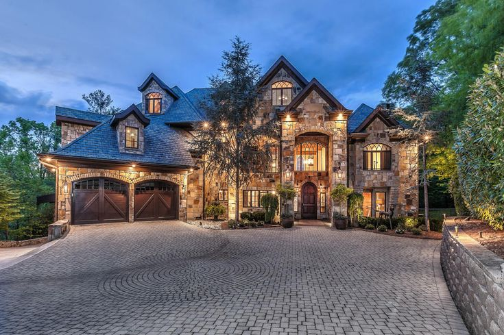 Location:12128 Warrior Trail,Knoxville, TN Square Footage: 9,611 (main house) Bedrooms & Bathrooms: 7 bedrooms & 8 bathrooms (main house) Price: $3,789,000 This stone mansion is located at1