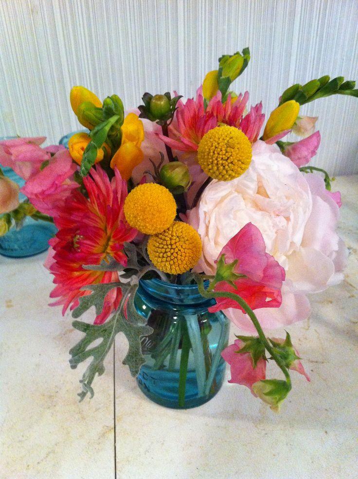 Beautiful Bright Flowers in Blue Mason Jar