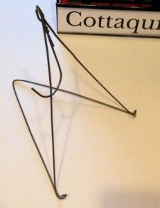 DIY easel made from wire coat hanger.