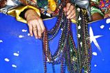 Ruby Gallagos holds a handful of beads before a Mardi Gras parade. (Justin Sullivan/Getty Images) - When is Mardi Gras 2014? about.com