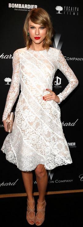 Dress – Oscar de la Renta  Shoes – Jimmy Choo  Jewelry – Lorraine Schwartz  Purse – Christian Louboutin