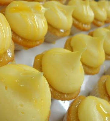 Mango, Pineapple & Passion Fruit Mini Cupcake Recipe    These beautiful cupcakes are vanilla bean & mango sponge, dipped in pineapple syrup, frosted with mango buttercream and drizzled with passion fruit glaze