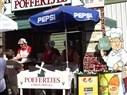 POFFERTJES : My favorite Dutch Donut, next to Oliebollen.  this is at the Lynden Washington Fair (usa)