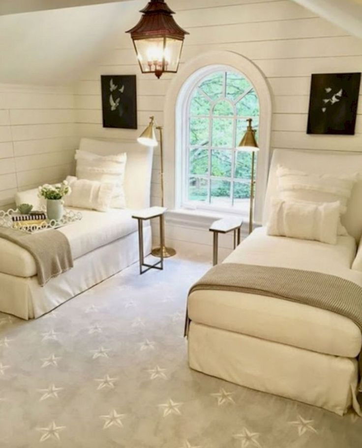 Simple Guest Bedroom with two twin beds... beautiful room with arched window and hanging lantern and shiplap walls and cozy headboards. #bedding