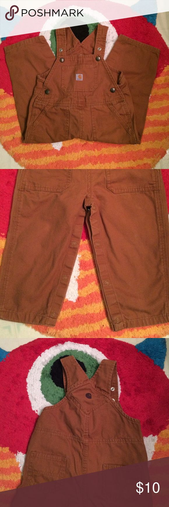 Carhartt bibs Gently worn, great condition. Looks like two spots with slight discoloration. Might come out in wash. Super cute bibs! Carhartt Bottoms Overalls