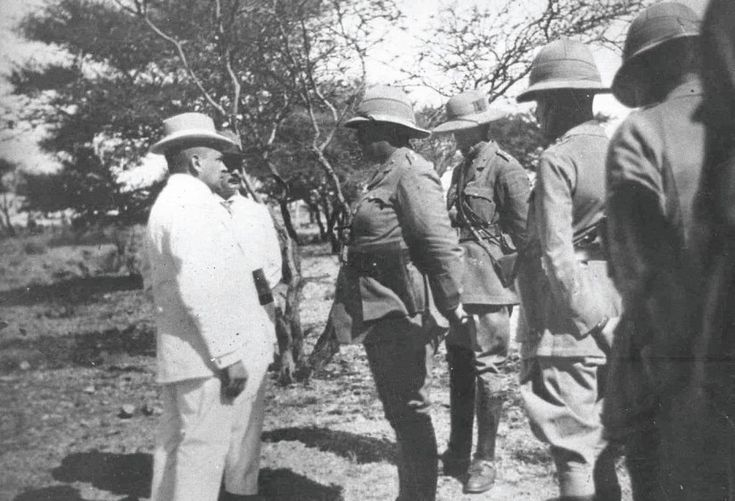 In the above picture dated May 12, 1915, Louis Botha, Prime Minister of the Union of South Africa (left) discusses the surrender of Windhoek, the capital of modern-day Namibia, with its mayor,Peter Müller. German Southwest Africa is crumbling under Botha's methodical, deliberate campaign, which has brought a far larger force to bear than the defenders can hope to match.