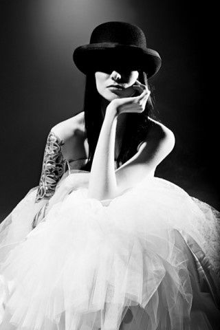 I would LOVE to see a bride walk down the aisle with a mans bowler instead of a veil!