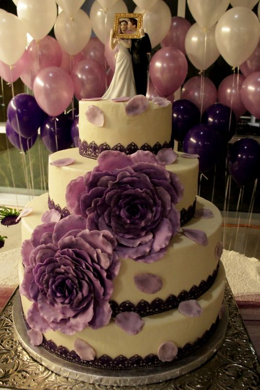 Double Rose and Petals Wedding Cake - Ombre Purple / Lilac / Lavender - Round stacked cake with gorgeous double roses with petals scattered over the tiers - Top Tier Wedding Cakes - Medford, Oregon