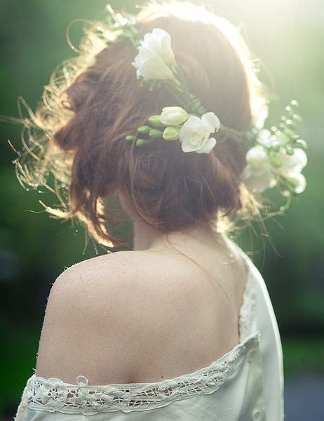 soft outdoor lighting, flowers in hair