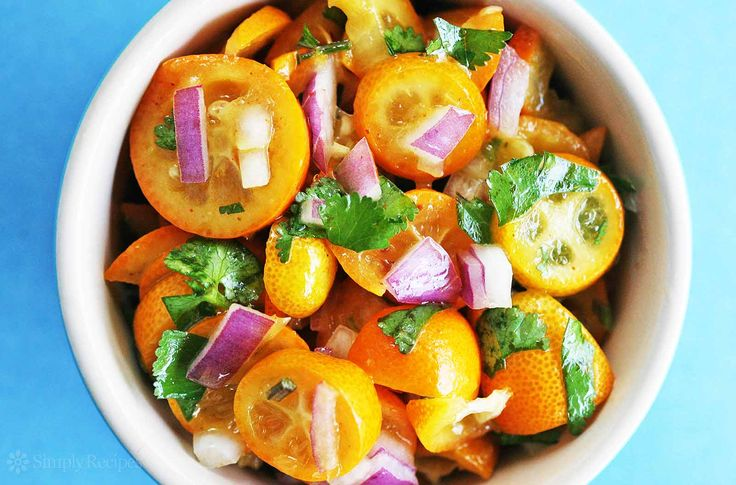 Festive kumquat salsa! Perfect for seafood or fish tacos, made with tiny kumquats, cilantro, and red onion. On SimplyRecipes.com