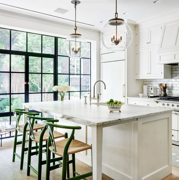 Island seating with white cabinets.  Love the globe pendants!  Nice faucet and countertop too.