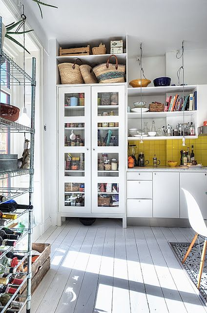a bit jamie oliver/carluccios with the metal racking - but quite like the white and the storage - for large kitchen/dining space not just kitchen