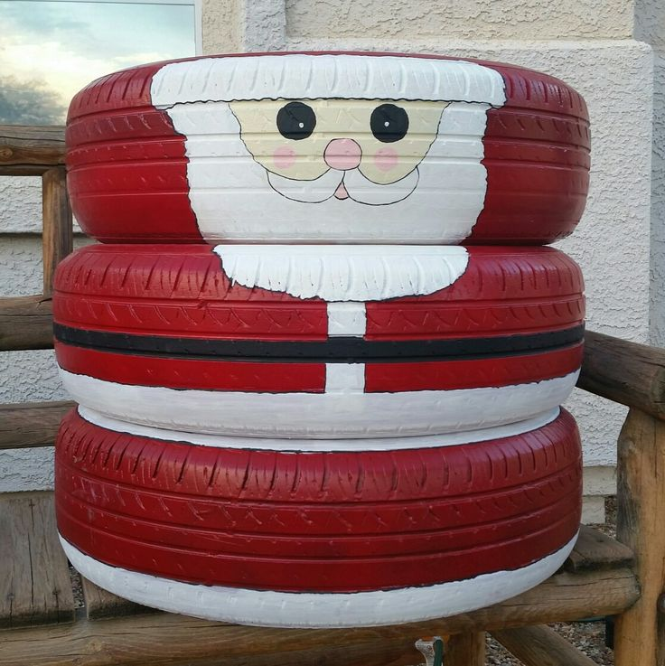 Santa Claus recycled old tires. DIY. Santa made from old tires, spray paint, acrylic paints, sealant. Christmas yard decoration. Image only.
