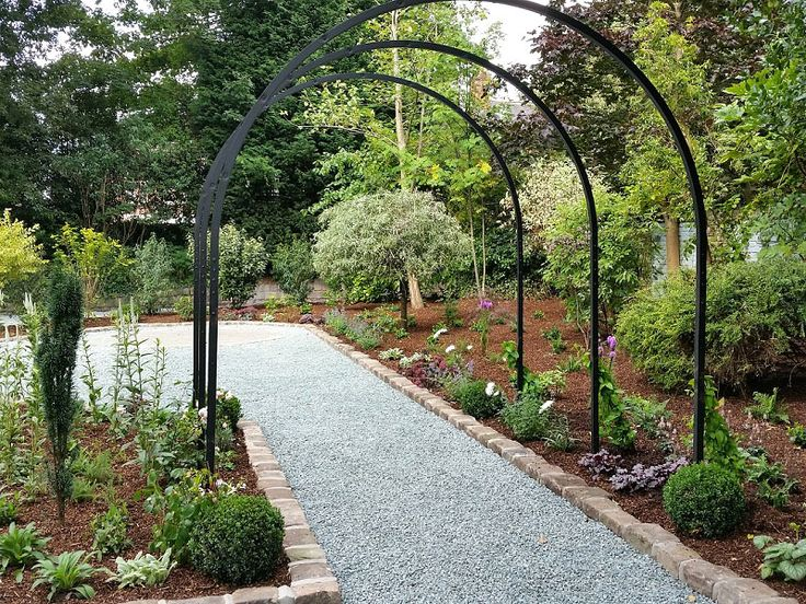 Garden Design & Planting #gardendesign #plantingdesign #gardenfeatures #reclaimedstone #gardenarches #shrubs #perennials #boxballs #roses #lavender #englishgarden #victoriangarden #gardendesigncheshire #plantingdesigncheshire