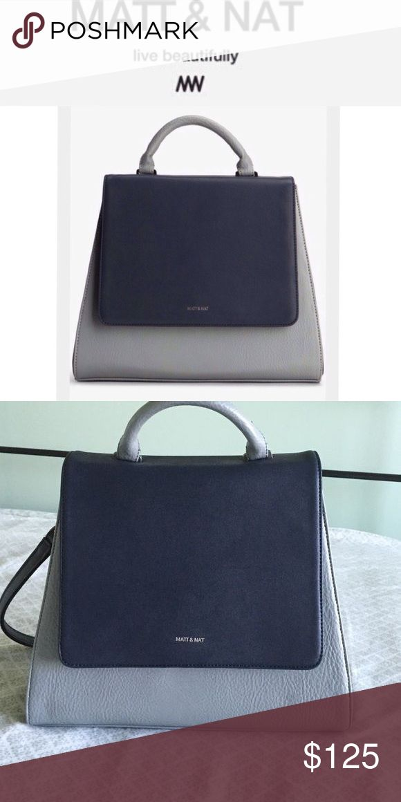 Matt and Nat Vegan Leather Handbag Beautiful Matt and Nat light blue and navy color block satchel. Comes with detachable shoulder strap fit easy carrying. This bag is like new condition. A bag that is chic and eco-friendly! Matt and Nat is a brand committed to not using leather or any other animal-based materials in designs and continue to explore new innovative ways to remain sustainable and eco-friendly. Matt and Nat Bags Satchels