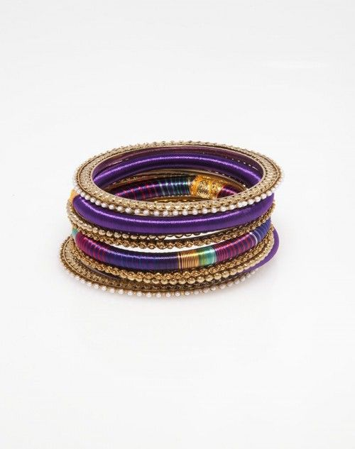 The matching pieces that make up the ends are wide, highly detailed, golden bangles with tiny pearl details around the edges. The two inner golden bangles have golden bumps all the way around. www.hamptonbanglecompany.com #bracelets #fashion #jewelry #trend #style #accessory #sexy #bangles  #imaginehappy