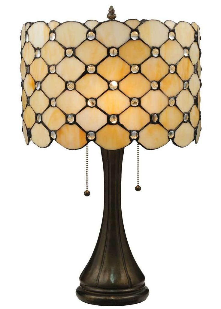 Diamond patterns of Iridized Ivory and Bone Beige area ccented with sparkling-clear, jeweled droplets in this elegant lamp.