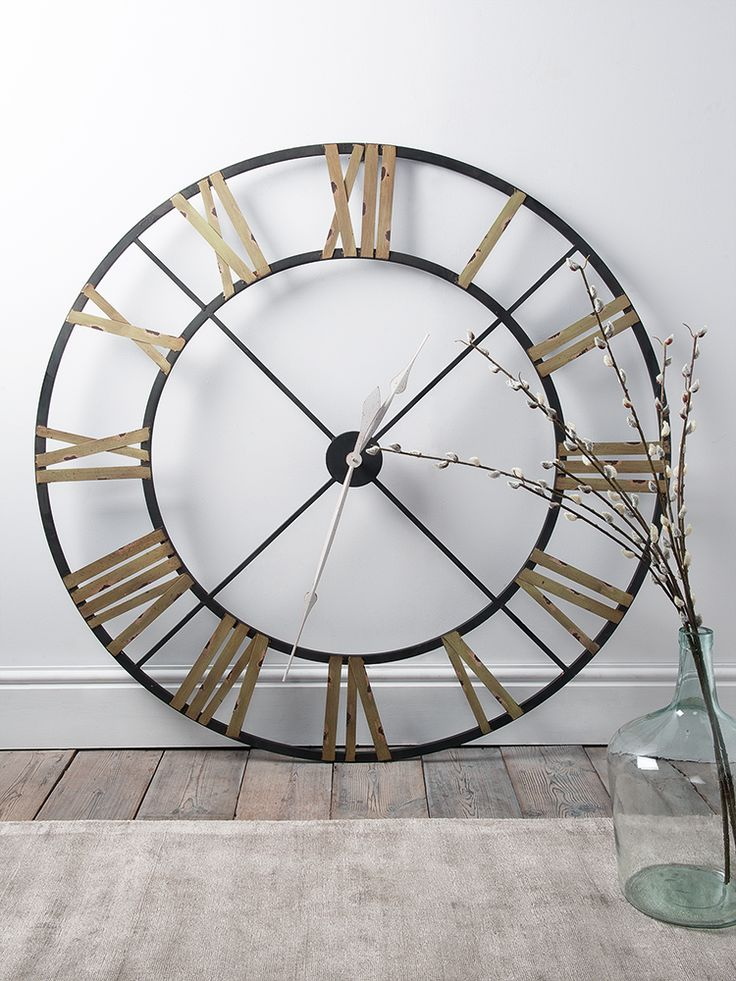 With a rustic aged metal wrought iron frame, our oversized and vintage inspired clock includes contract painted roman numerals and classic white metal hands. This weighty skeleton clock can be easily hung with the metal loop on reverse, but looks just as good propped against a wall or on a console table.
