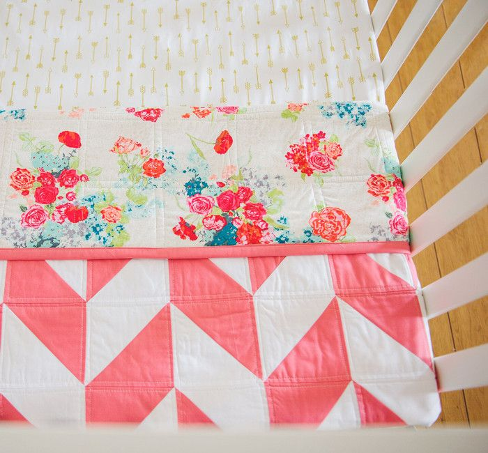 "This Herringbone quilt is so gorgeous! ""The Emma"" is handcrafted with Coral and White KONA fabric, 100% cotton quilting grade fabric. The backing is of a beautiful floral pattern in Corals hues and wh"