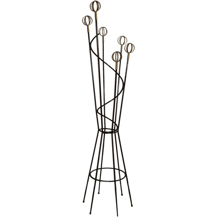 for sale on coat hat rack attributed to roger feraud black metal frame with organic lines and six brassplated astro balls