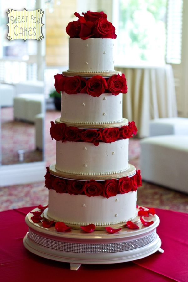 Four Tier Round Ercream Wedding Cake With Separators And Fresh Red Roses In Between