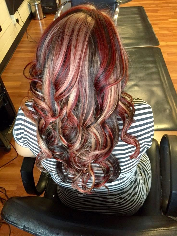 Hair by Heather. Chunky highlight lowlight with black red and blonde.