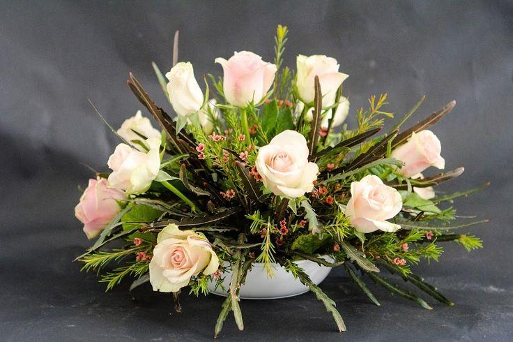Floral design, round arrangement with roses, Chamelaucium and Dizygotheca elegantissima  · Album by Yana Gourenko