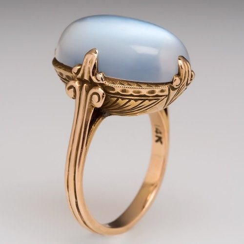 Antique Large Moonstone Etched Cocktail Ring 14K Gold. This awesome antique moonstone cocktail ring is centered with a four prong set 9.25 carat moonstone. The stone is quite clear and shows great adularescence. The stone sits atop a hand made highly decorated 14k yellow gold setting. The ring is still in great shape with crisp etchings.
