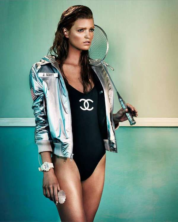 silver metallic jacket from Jeremy Scott for Adidas and a black Chanel swimsuit