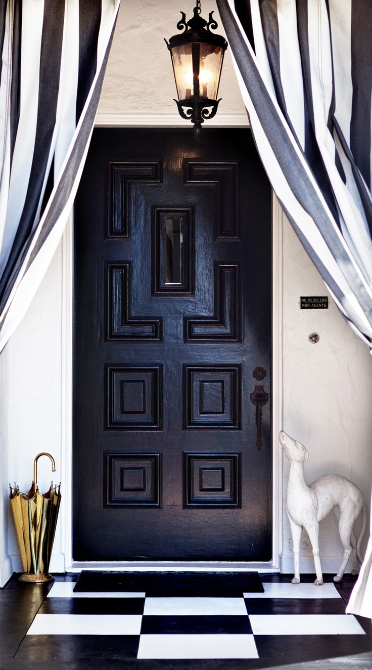 Make an entrance with front door black and white stripe draperies against a black lacquer door and checkered floors!