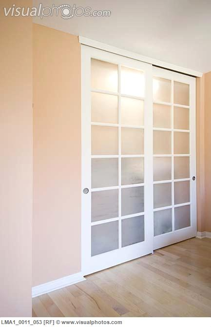 Image detail for -Sliding closet doors in peach colored room [LMA1_0011_053] > Stock ...