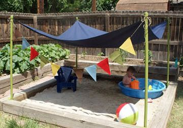 Such a good idea.  Kids will love this.  Backyard beach with shade. Play sand. Kid summer activity.