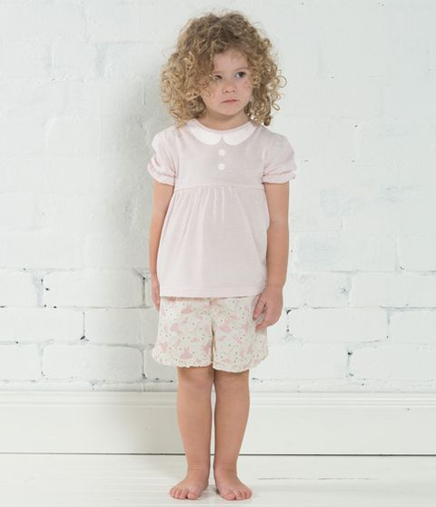 Pink sleepwear set for your little princess. This junior style pj set will become her favourite pair of pj's for bed time. Top features 100% Cotton baby doll. Short frilled hem detail with ballerina print on 100% Cotton Also available in pink. Sizes available: Small, Medium, Large Comes in matching gift box