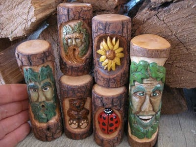 Scrap Walking Stick Creations: I began carving faces, flowers, and bugs on the scrap pieces of wood that I cut off my walking sticks. For years I looked at those nice pieces of wood... some sourwood, rhododendron, or perhaps dogwood and just didn't feel right about tossing them out or into the wood heater so I began to carve these nifty little creations.