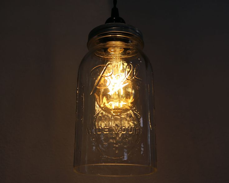 This kit lets you easily hang a beautiful Mason jar pendant light in your home! The only thing you need to add is a standard Edison base (E26/E27) light bulb. Our pictures have an LED bulb we found at Lowe's.  Kit includes a hand cut open bottom Ball or Kerr Mason jar, a stainless steel ventilated lighting lid, a 16 foot long black cloth covered cord with an on/off switch, that plugs into the wall, and 2 metal ceiling hooks.