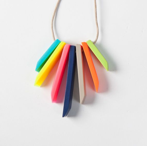 Dear Mabel Handmade jewelry. This beautiful necklace was made out of clay that was mixed by hand. Each bar is slightly different as they are individually made which adds to
