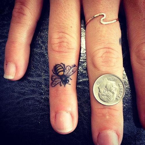 Tiny Bee Finger Tattoo | Devin Mena of Laguna Tattoo