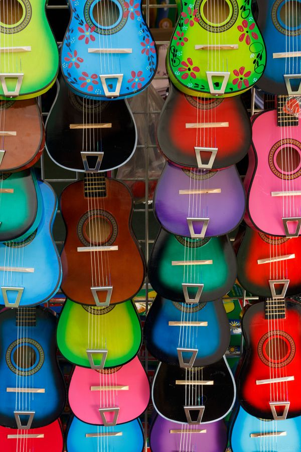 "500px / Photo ""Guitars for Sale"" by Victor Parral........One of the many vendor stands on Olvera Street in Downtown Los Angeles displaying colorful, small gutars. Upon sale, these guitars can be customized with a name engraving."
