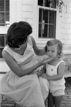 Jackie Kennedy strokes the face of daughter Caroline. Hyannisport, MA, 8/28/60