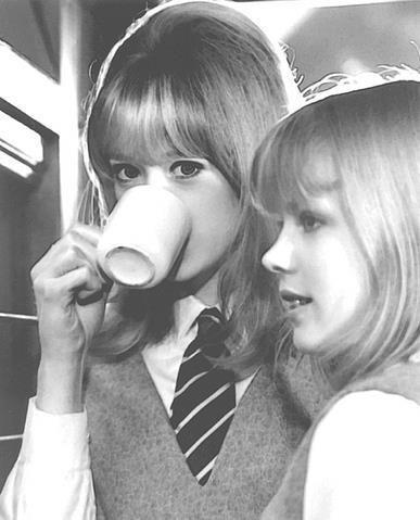 Pattie Boyd sips tea on the set of A Hard Day's Night, 1964