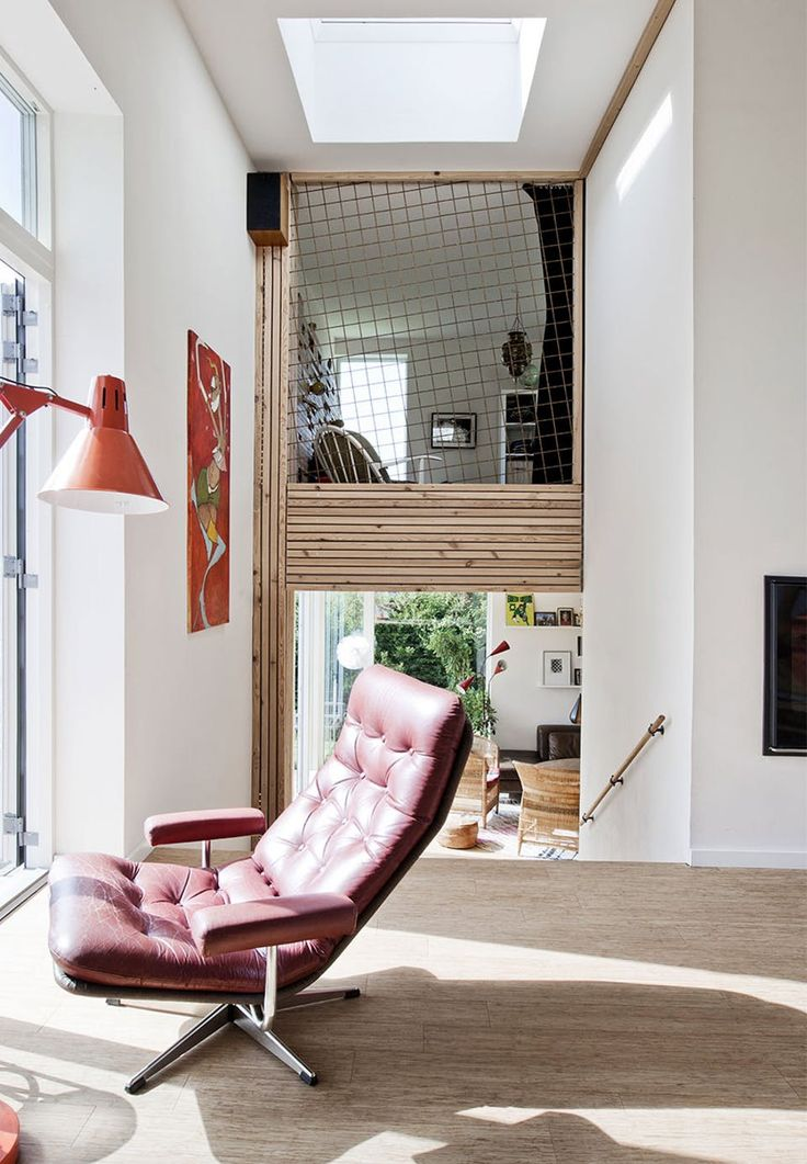 A reading space in the sun in a read leather chair - a small spot in the hallway.