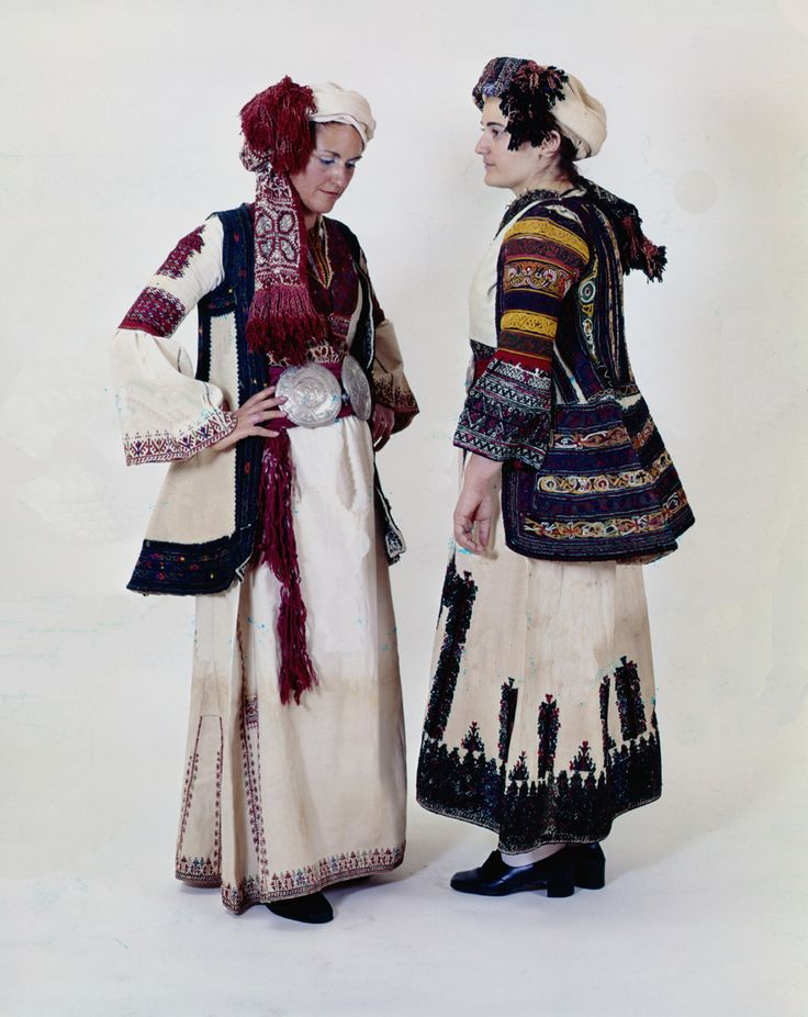 Two costumes from Corinthia and Stymphalia, Peloponnese of the same sartorial  family worn before the middle of the 19th c. in all Peloponnese and central Greece. Each  village bears a particular group of embroideries on all costume parts.  Size 	Right: H(chemise)1.30 - (bodice)0.36 - (coat)0.75, Left: H(chemise)1.27 - (bodice)0.31 - (coat)0.85 m  Date 	Early 20th c.