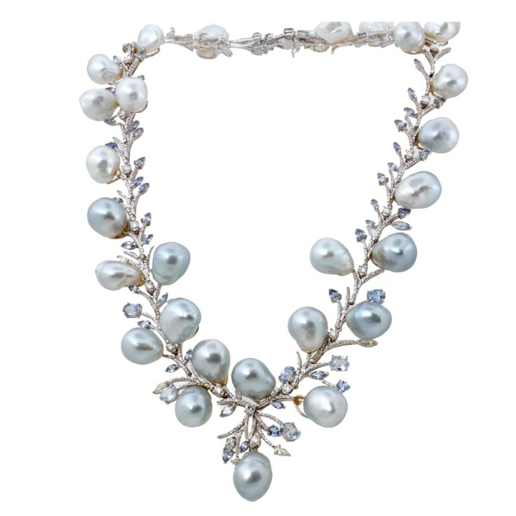Diamond South Sea Baroque Pearl Gold Sapphire Necklace    Contemporary  This stunning necklace is a one-of-a-kind work of art. The light blue-grey baroque South Sea pearls are so, so gorgeous. They play together so well with the light blue sapphires and white diamonds. When 10 carats of diamonds are the third most interesting about a piece of jewelry, you know it's something special.