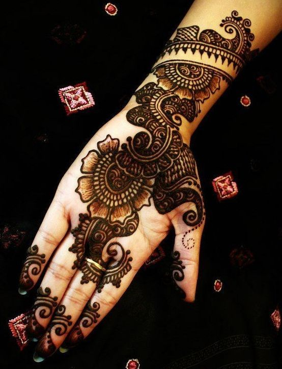 Black mehndi designs are very popular especially amongst the younger generation. The difference in colours really brings out the design. Here are the best desig | See more about mehndi designs, henna designs and mehndi.
