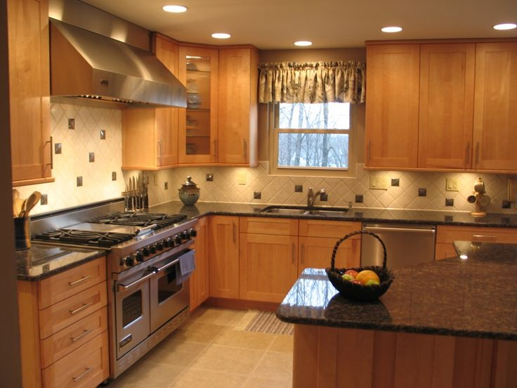Tan Brown/ Sapphire Blue granite counters with oak