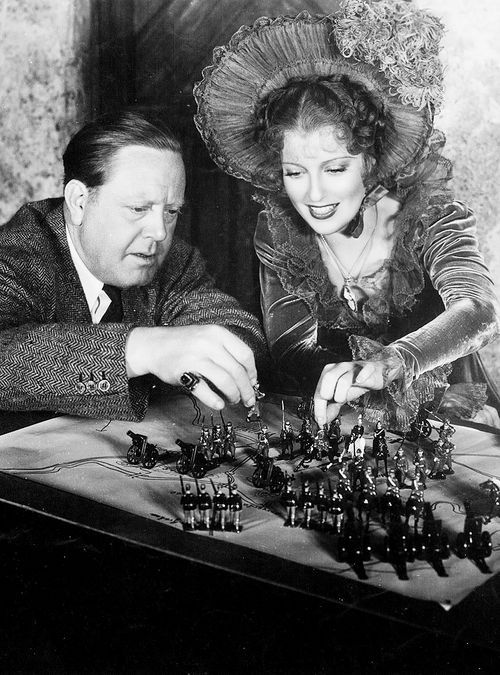 """Director Robert Z. Leonard and Jeanette MacDonald on the set of """"The Firefly"""", 1937"""