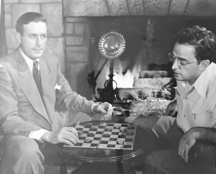 Lawrence Tierney plays checkers with writer Charles Samuels  on the set of San Quentin (1946)
