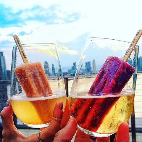 Loopy Doopy Rooftop Bar at the Conrad New York is now selling what may be the most genius summer cocktail of all time. Seriously. No exaggeration.  Presenting the cocktail you're going to be drinking the second the sun comes out: a glass of prosecco with an ice lolly thrown in.