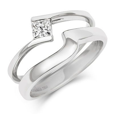 The fun shaped Flat Sweep Wedding Ring fits around the most unusual of engagement rings